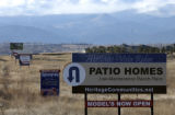 Signs along State Hwy 7 advertise new homes in Erie, Colorado Tuesday, December 27, 2005.   Denver...