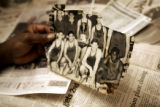 Herman Carr (cq), 77, holds a photo of himself (far right in photo) on a U.S. Army team on which...