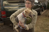Kathleen Orozco, (cq), holds one of the dogs she will foster until a home can be found. Bonnie...