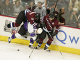 Colorado's Ian Laperriere, left, and Alex Tanguay tangle with Los Angeles' Nathan Dempsey during...