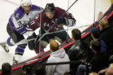 L.A.'s Michael Cammalleri, left, collides into the boards with Colorado's Ossi Vaananen in the...