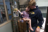 Marc  DeSplinter (CQ) holds son Micah DeSplinter (CQ), 4, who was being machine fed because he has...