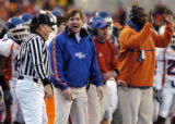 Greg Kreller / Idaho Press-Tribune Boise State head coach Dan Hawkins disagrees with a call made...
