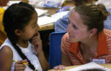 (DENVER, Colo., July 12, 2004) Veronica Lopez , 8, gets help with her math by her teacher Erika...