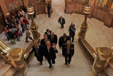 Colorado Governor Bill Owens walks past a school group touring the Colorado State Capitol as he...