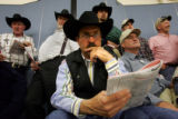 Rancher Roger Shire, cq, of Pond Creek, OK, watches the Angus Bull Sale intently during the 100th...