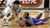 PAKS101 - Pittsburgh's Ronald Ramon, left, dives for a loose basketball with  DePaul's Jabari...