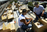 (DENVER, Colo., JULY 1, 2004)  Josh Haupt and Zach Taminosian (lt.-rt.) work atop a platform on...