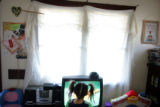 Ivy Medina, cq, 4, watches cartoons in her Denver home on Thursday, December 29, 2005.  Her...