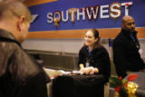 Southwest Airlines employee Brittany Eberson takes baggage for a passenger at Philadelphia...