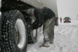 Alex Portillo(cq) from Silvethorne chains up an 18 wheeler just before the Eisenhower tunnel...