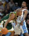 JPM426  Denver Nuggets Greg Buckner, right, tries to slow Seattle Supersonics Ray Allen in the...