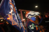 **1/13/06** Jesse Cooper of Denver shows his Bronco Pride during a pep rally for the Denver...