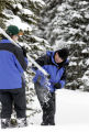 Chris Pacheco (cq), 46, right, clears snow out of a Federal Snow sampler, a 12 ft. tube used to...