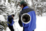 Chris Pacheco, 46, left, and Mike Gillespie (cq), 49, right use a Federal Snow sampler, a 12 ft....