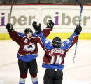 The Colorado Avalanche's Ian Laperriere (#14) celebrates his game winning goal with teammate Brad...