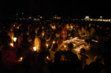 Friends of Ian Wallace and Joshua Bankett-Land gather for a candlelight vigil at a skate park at...