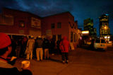 (1/12/06) Day laborers board vans outside of the Centro Humanitario Thursday morning to work...