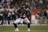 Denver Broncos #56-Al Wilson celebrates a tackle during the first drive against the New England...