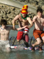 Eric Harman (cq), center, Boulder,  reacts to jumping into the cold water Sunday morning January...