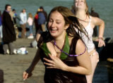 Melissa Whalen (cq), a CU student - left, and her friend Claire Macqun (cq) run for the hot tubes...