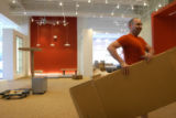 (DENVER, Colo., July 1, 2004)  Matt Wilkerson, Area Manager of Design Within Reach, moves an empty...