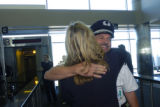 Southwest employee Wendy Parkinson (cq - left) welcomes pilot Jeffrey Kilponen (cq -right) after...