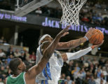 Denver Nuggets forward Carmelo Anthony shoots over Boston Celtic center Mark Blount, left, in the...