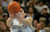Denver Nuggets forward Edwardo Najera pulls down one of his seven rebounds during the second...