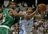 Denver Nuggets guard Andre Miller right, drives past Boston Celtic center Mark Blount, left, in...