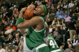 Boston Celtic forward Paul Pierce, middle, gets swiped at by Denver Nuggets forward Kenyon Martin,...
