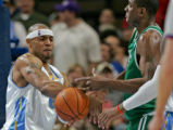Denver Nuggets forward Kenyon Martin, left, steals the ball from Boston Celtic center Mark Blount,...