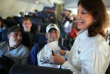 Southwest Airlines flight attendant Patty Ball, cq, right, Fort Worth, laughs with passengers Matt...