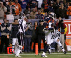 Denver Broncos cornrerback Champ Bailey, right, intercepts a pass intended for New Englad Patriots...