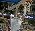 Denver Nuggets forward Carmelo Anthony, right, drives past Cleveland Cavaliers star LeBron James,...