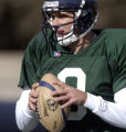 Quarterback John Dutton looks to pass as the Colorado Crush hold their first practice of the...