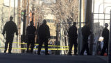 Denver Police recruits and officers search the alley of the 1400 block of Pennsylvania Street...