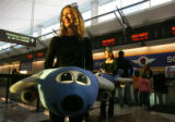 Michelle Van Eynde (cq), financial analyst for Southwest Airlines in Dallas, greets customers at...