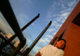 Javier Guzman, 14, hangs out on a fire escape where his brother Edgar Chocoy use to sit and look...