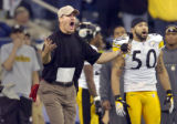 Steelers head coach Bill Cowher and Larry Foote look to the referees in disbelief after they ruled...