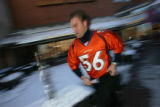 Andrew Meineke, 30, a valet for the Cherry Creek Shopping Center, heads to retrieve a car as he...