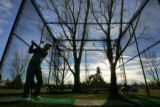 Sam Valuck (cq), 81, practices his golf shot at the Windsor Gardens golf course in Aurora on...
