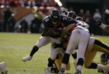380 Broncos #38 Mike Anderson tries to gain some yards during the second quarter at Invesco Field...
