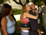 (COLORADO SPRINGS, Colo., July 16, 2004)  June Colvin hugs Falon Adams, right, as Cassandra...