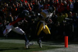 1361 Denver's Champ Bailey tries to catch Pittsburgh Steelers wide receiver Cedrick Wilson as he...