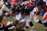 Broncos quarterback #16 Jake Plummer fumbles the ball on a fourth and 10 to go during the fourth...