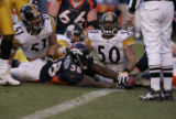 152 Denver's #38 Mike Anderson stretches into the end zone past Pittsburgh's  #51 James Farrior...