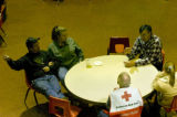 (Thurs., Jan. 4, 2005) Berthoud evacuees and Red Cross Volunteers sit inside the Berthoud High...