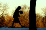 Luke McCluskey (cq) spent the late afternoon playing basketball at Washington Park Monday January...