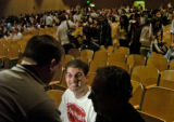 **1/23/06** Brandon Silveria, center, and father Tony Silveria, right, are interviewed by a...